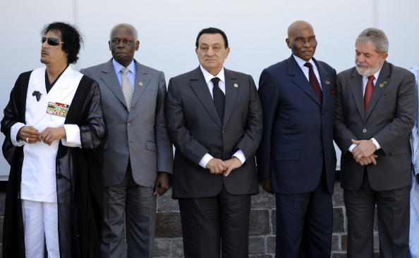 (L to R) Libyan Leader Moamer Kadhafi, Angolan President Jose Eduardo dos Santos, Egyptian President Hosni Mubarak, Senegalese President Abdoulaye Wade and Brazilian President Luiz Inacio Lula da Silva are pictured after a meeting of the Group of Eight (G8) and participating African countries during the G8 summit in L'Aquila, in central Italy, on July 10, 2009. G8 leaders, including an Africa-bound Barack Obama, vowed today to stand by the world's poor despite the downturn, unveiling a 15 billion dollar boost for food production. AFP PHOTO / STEPHANE DE SAKUTIN (Photo credit should read STEPHANE DE SAKUTIN/AFP/Getty Images)