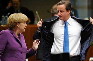 German Chancellor Angela Merkel (L) talks with British Prime Minister David Cameron prior to a working session on the second day of a European Union summit on October 29, 2010 at the European Council headquarters in Brussels. The European Union faced a new round of risky treaty change Friday after its leaders agreed to embark on landmark reforms designed to wade off another financial crisis by shoring up the euro. AFP PHOTO / ERIC FEFERBERG (Photo credit should read ERIC FEFERBERG/AFP/Getty Images)